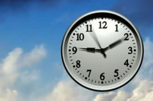 stock-footage--d-animation-of-a-wall-clock-running-very-fast-through-hours-clouds-fly-past-in-the-background
