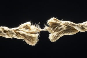 fraying-brown-fiber-rope-against-black-background-1